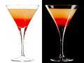Cold alcoholic cocktail a couple of identical cocktails isolated on white and black Stock Photos