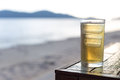 Cold beer on the beach table beside Royalty Free Stock Photography