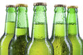 Cold beer bottles closeup of with water drops isolated on white Royalty Free Stock Image