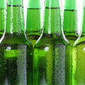 Cold beer drinks in bottles with water drops Royalty Free Stock Photo
