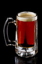 Cold beer frozen mug with an irish red ale isolated on a black background Stock Photography