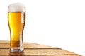 Cold beer glass on the bar table. Clipping paths. Royalty Free Stock Photo