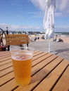 Cold beer on a hot day the beach summer vacation Stock Photos