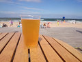Cold beer on a hot day the beach summer vacation Royalty Free Stock Photography