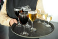 Cold beer, soft drinks and white wine, bartender, catering service Royalty Free Stock Photo