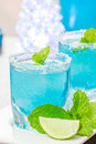 Cold blue hawaiian cocktail in a night party Stock Photos