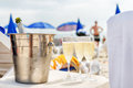 Cold champagne on the beach. Summer holiday relax. Royalty Free Stock Photo