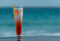 Cold cocktail on the beach against sea Stock Photography