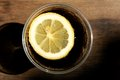 Cold cola drink a with slice of lemon in a glass on a hot day Royalty Free Stock Photos