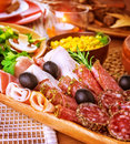 Cold cuts closeup on in centerpiece of table various of smoked meat bacon beef ham pepperoni salamy restaurant menu Royalty Free Stock Photography