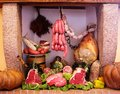 Cold cuts and meat composition of italian in an old fireplace Royalty Free Stock Images