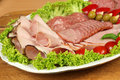 Cold cuts party banquet plate with of polish ham and sausage traditional polish smoked meat Stock Photography