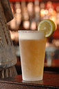 Cold draft beer an ice in a chilled glass on the counter at a bar Royalty Free Stock Image