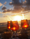 Cold drink at the beach sunset Royalty Free Stock Photo