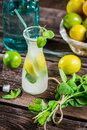 Cold drink with fresh citrus fruit on old wooden table Royalty Free Stock Image