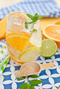 Cold drink with lemons and oranges lemonade Royalty Free Stock Photo