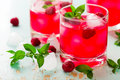 Cold drink with raspberry mint and ice in a glass style vintage selective focus Royalty Free Stock Photos