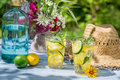 Cold drink served in a summer garden on old wooden table Royalty Free Stock Photo