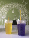 Cold drinks yellow and violet drink at a nice coffeeshop Royalty Free Stock Photos