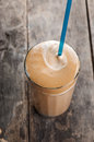 Cold Frappe drink on a wooden table Stock Photography