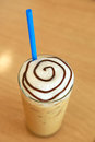 Cold fresh ice coffee with tube color blue Royalty Free Stock Photo