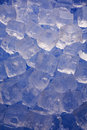Cold frosty ice cubes on blue background Royalty Free Stock Photo