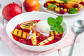 Cold fruit soup with raspberry, grilled nectarines and ice cream Royalty Free Stock Photo