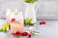 Cold green iced tea with lime and raspberry Royalty Free Stock Photo