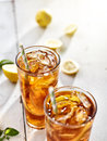 Cold ice tea with sliced lemons and straws photo of two shot a copyspace composition Stock Photo