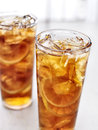 Cold iced tea with lemons close up photo of Stock Photos