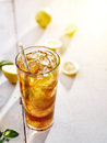 Cold iced tea with lemons and copy space composition Stock Image