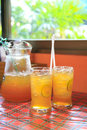 Cold lemon tea in glasses and jar Royalty Free Stock Photos