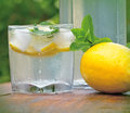 Cold lemonade with lemon refreshes in summer heat Stock Photos
