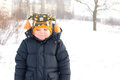 Cold little boy in winter snow Royalty Free Stock Photo