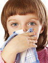 Cold - little girl blowing her nose Royalty Free Stock Images