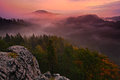 Cold misty foggy morning with twilight sunrise in a fall valley of Bohemian Switzerland park. Hills with fog, landscape of Czech R Royalty Free Stock Photo
