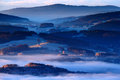 Cold morning in Sumava National park, hills and villages in the fog and rime, misty view on czech landscape, blue winter scene, Tr Royalty Free Stock Photo