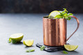 Cold Moscow Mules cocktail with ginger beer, vodka, lime Grey stone background Copy space Royalty Free Stock Photo