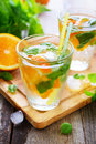 Cold orange drink with basil and ice Stock Photo