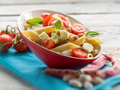 Cold pasta salad slice tomatoes mozzarella beans Royalty Free Stock Photography