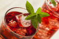 Cold refreshing berry hibiscus ice tea iced with mint Royalty Free Stock Photos