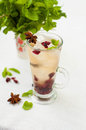 A cold refreshing drink with mint ice and anise star anise Royalty Free Stock Photos