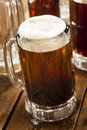Cold refreshing root beer with foam in a mug Royalty Free Stock Photography