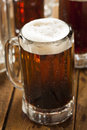 Cold refreshing root beer with foam in a mug Stock Photography