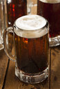 Cold refreshing root beer with foam in a mug Royalty Free Stock Images