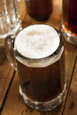 Cold refreshing root beer with foam in a mug Royalty Free Stock Image