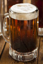 Cold refreshing root beer with foam in a mug Royalty Free Stock Photo