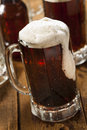 Cold refreshing root beer with foam in a mug Royalty Free Stock Photos