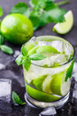 Cold refreshing summer drink with lime, mint and ice cubes Royalty Free Stock Photo