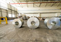 Cold rolled steel coils in storage area ready to feed to machine Royalty Free Stock Photo